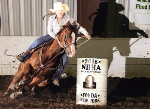 Nikki Becker rides Hammer in a barrel race